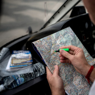 Doctor Dan Sermand from MSF, finds the location on a map where today's delivery will go.