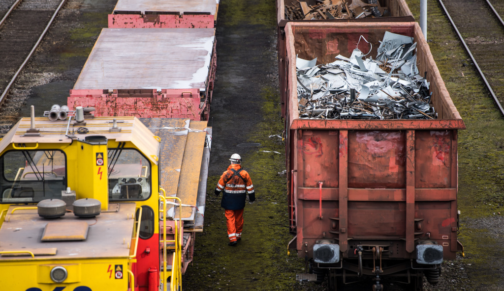 Trains with scrap metal stay in front of the Huettenwerk Krupp Mannesmann GmbH steel mill in Duisburg, Germany. President Trump is expected to order tariffs on aluminum and steel imports as early as Thursday.