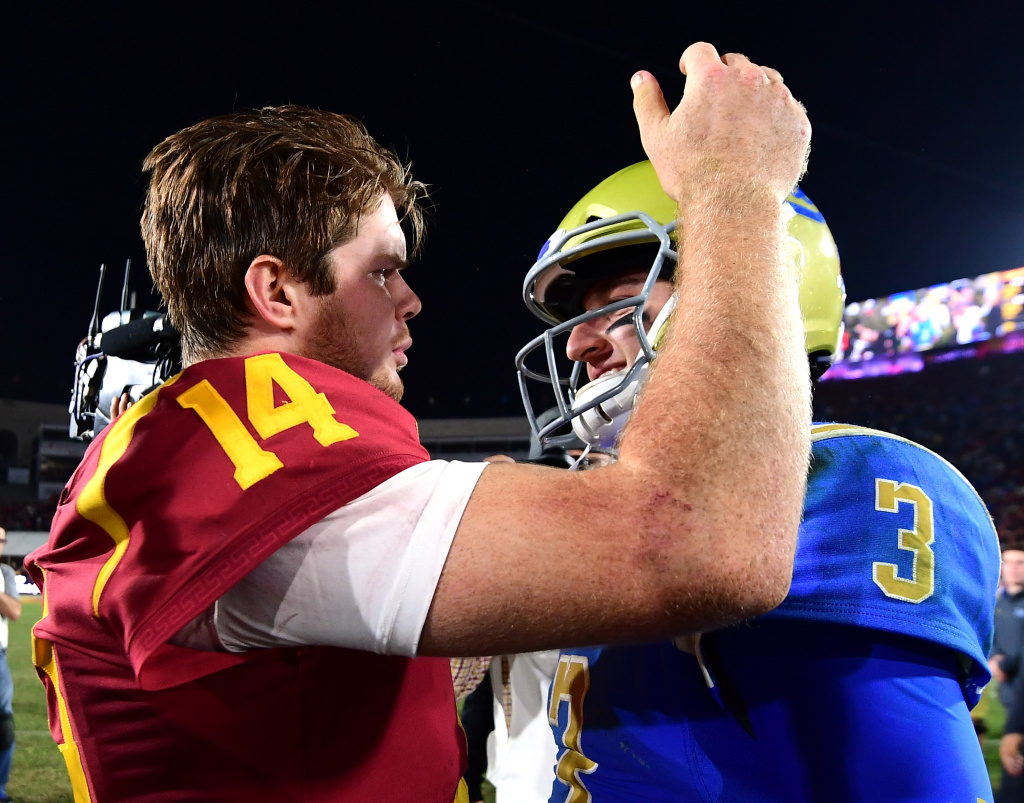 Josh Rosen #3 of the UCLA Bruins and Sam Darnold #14 of the USC Trojans meet on the field after a 28-23 Trojan win at Los Angeles Memorial Coliseum on November 18, 2017.