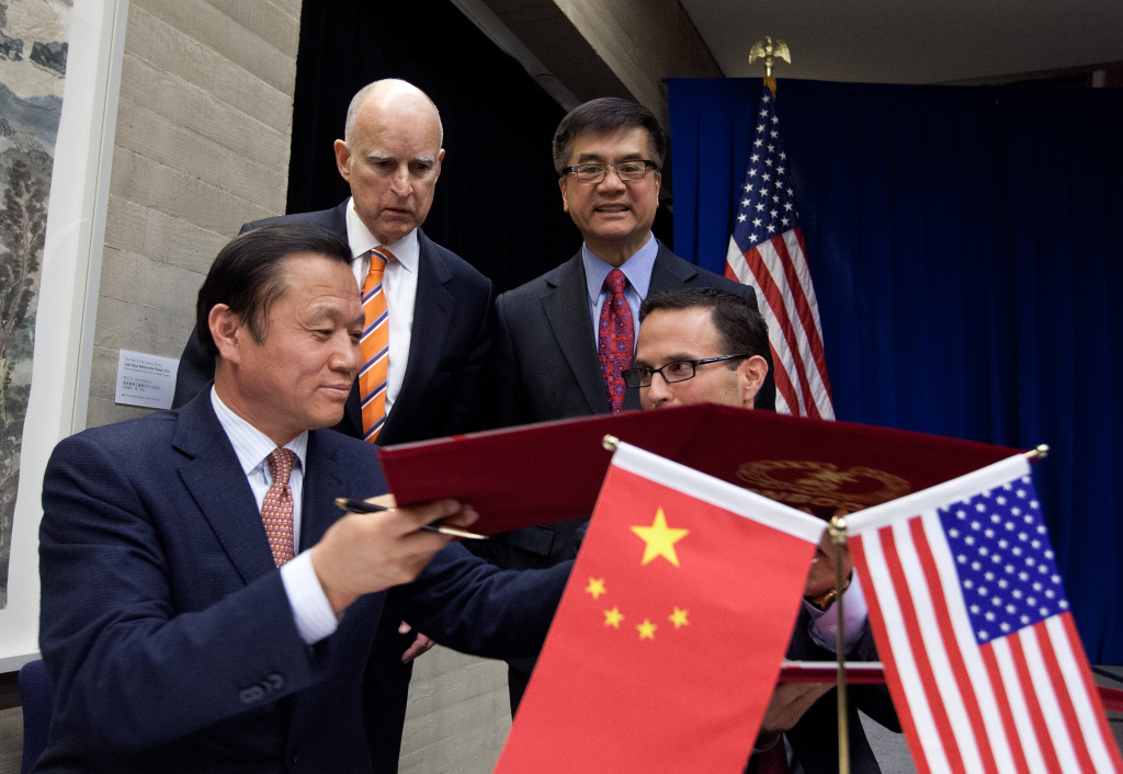 In file photo, Gov. Jerry Brown is shown during a visit to China in 2013. Wednesday, Brown pointed to more than a dozen accords on sharing training and knowledge for cleaner energy with the country.