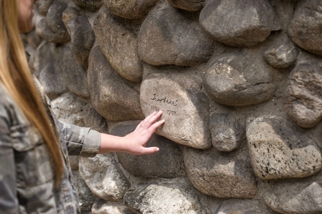 Visitors were asked to look for the three Lummis family members whose names are carved into the stones of the Lummis home.