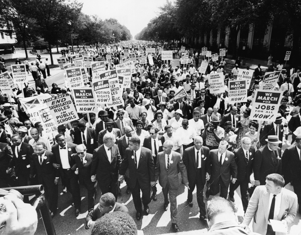 Civil rights Leaders hold hands as they lead a crowd of hundreds of thousands at the March on Washington for Jobs and Freedom, Washington DC, August 28, 1963.