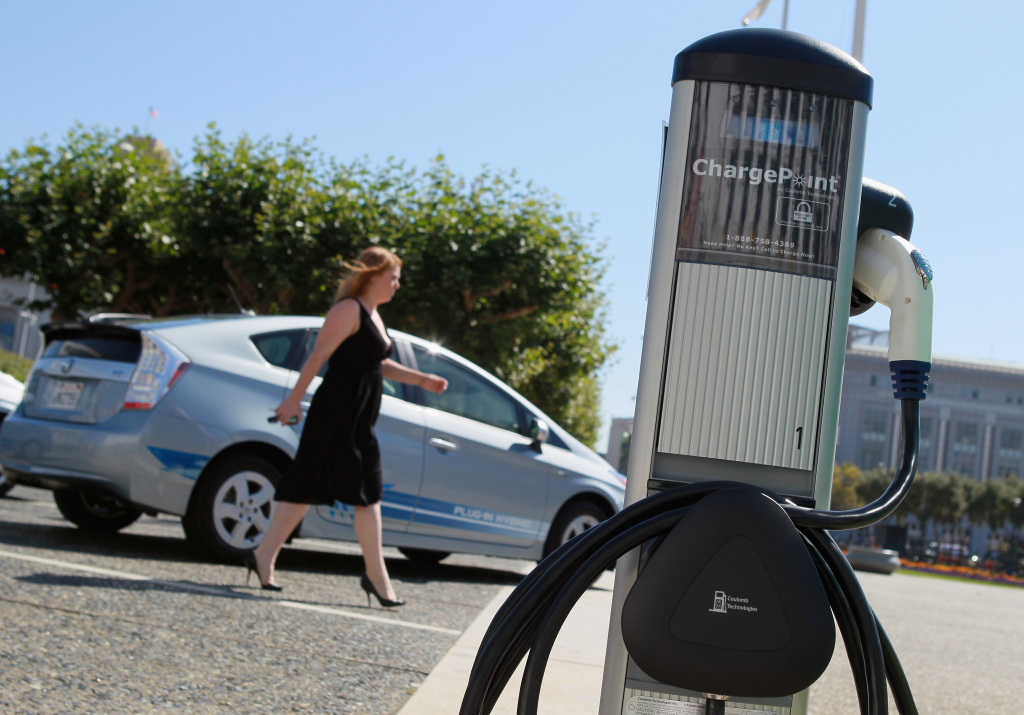 A pedestrian walks by a new electric vehicle charging station near San Francisco city hall August 25, 2010 in San Francisco, California.