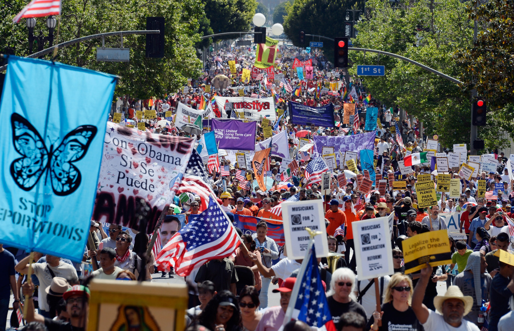 Thousands of people participate in the May Day march and rally on May 1, 2013 in Los Angeles, California. Labor organizations and immigration groups used the annual celebration to push for an immigration system overhaul.