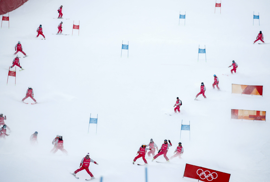 Slippers prepare the ski course before the first run of the women's giant slalom at the 2018 at the Pyeongchang Winter Olympics.