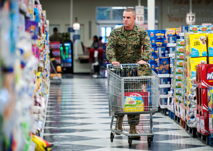 A customer loads his cart with drinks at the Commissary at Camp Pendleton on Wednesday, Jan. 24. With the help of government subsidies, prices at military grocery stores are an average of 30 percent less than at commercial stores.