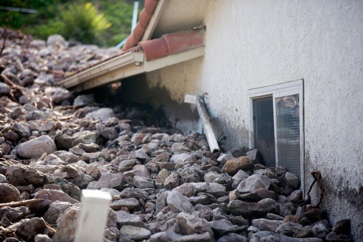 Ventura County Fire estimates that 12 feet of debris slid onto Gitana Avenue after an overnight storm caused mudslides in Camarillo Springs on Friday afternoon, Dec. 12, 2014.