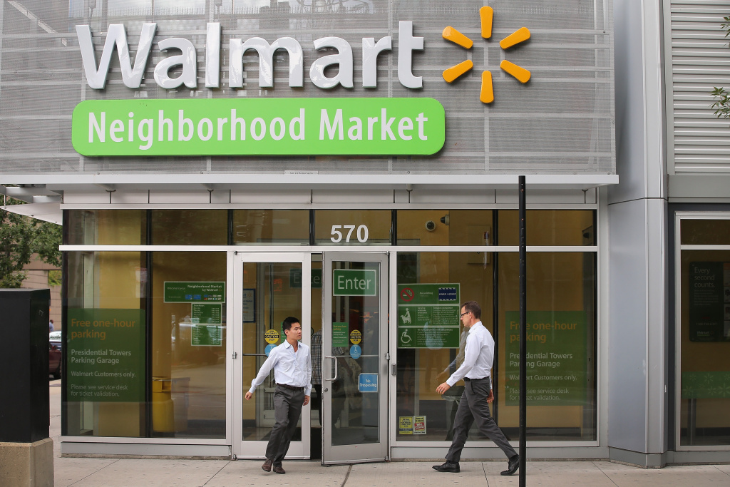 CHICAGO, IL - AUGUST 15:  Customers shop at a Walmart Neighborhood Market store on August 15, 2013 in Chicago, Illinois. Walmart, the world's largest retailer, reported a surprise decline in second-quarter same-store sales today. The retailer also cut its revenue and profit forecasts for the fiscal year.  (Photo by Scott Olson/Getty Images)