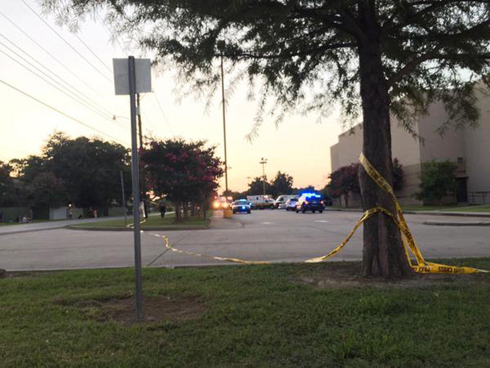 Police tape surrounds the scene following a shooting at a movie theater Thursday, July 23, 2015, in Lafayette, La. (Treylan Arceneaux via AP)