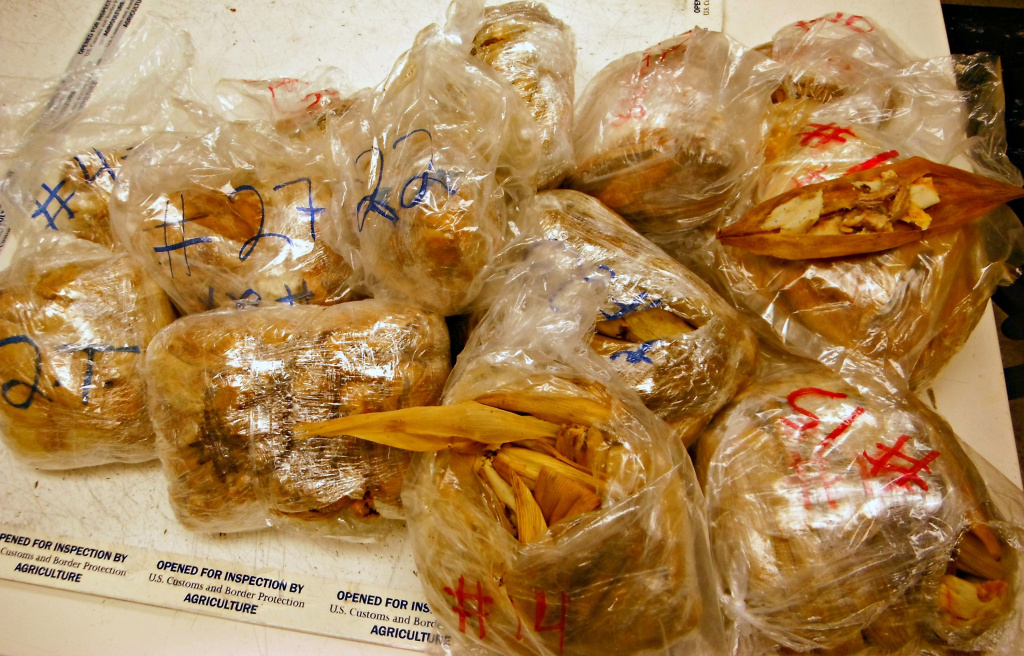 Photo released by the U.S. Customs and Border Protection shows seized 450 prohibited pork tamales discovered inside the luggage of a passenger arriving at Los Angeles International Airport from Mexico, on Nov. 2, 2015.