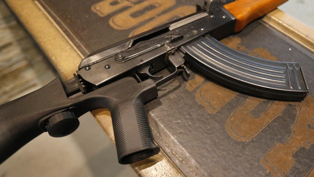 Bump stocks like this one installed on an AK-47 are now illegal in the U.S., after the Trump administration changed how they are legally defined.  The devices can allow a semi-automatic rifle to fire nearly as fast as a machine gun.