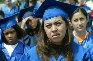 File photo: Nelly Rodriguez (foreground), a student at Wichita High School in Wichita, Kansas, and originally from Mexico, participates in a mock graduation ceremony at the West Front of the U.S. Capitol April 20, 2004 in Washington, DC.