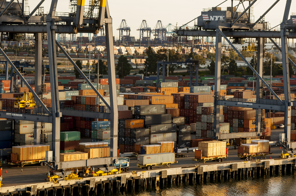 In this Jan. 14, 2015, photo,  shipping containers are stacked up waiting for truck transport at the Port of Los Angeles.