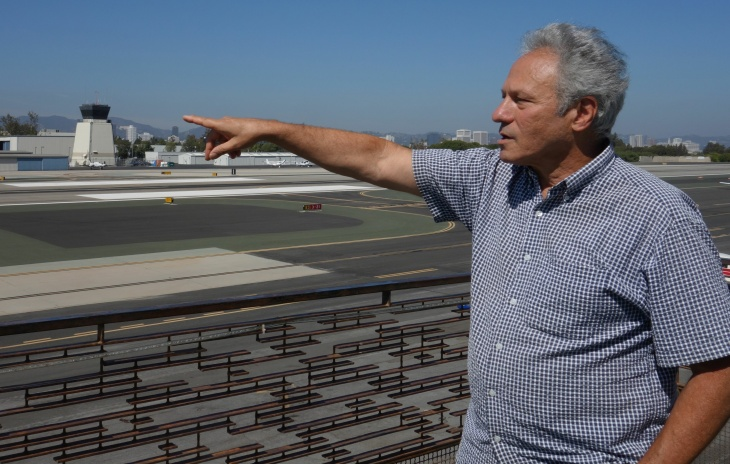 Martin Rubin, director of Concerned Residents Against Airport Pollution, points out the spot at Santa Monica Airport where a small jet crashed on Sept. 29, killing four people. His group is among those hosting an upcoming meeting to envision alternate uses for the airport.