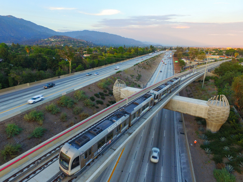 A Gold Line train heads over the eastbound 210 toward Arcadia Station.