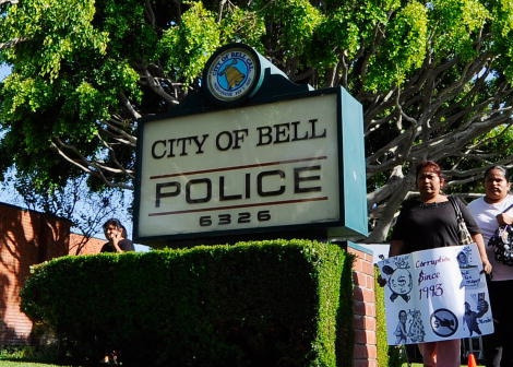 Residents of the City of Bell, holding protest placards are calling for the ouster of city officials arrive for the start of council meeting on July 26, 2010 in Bell, California.