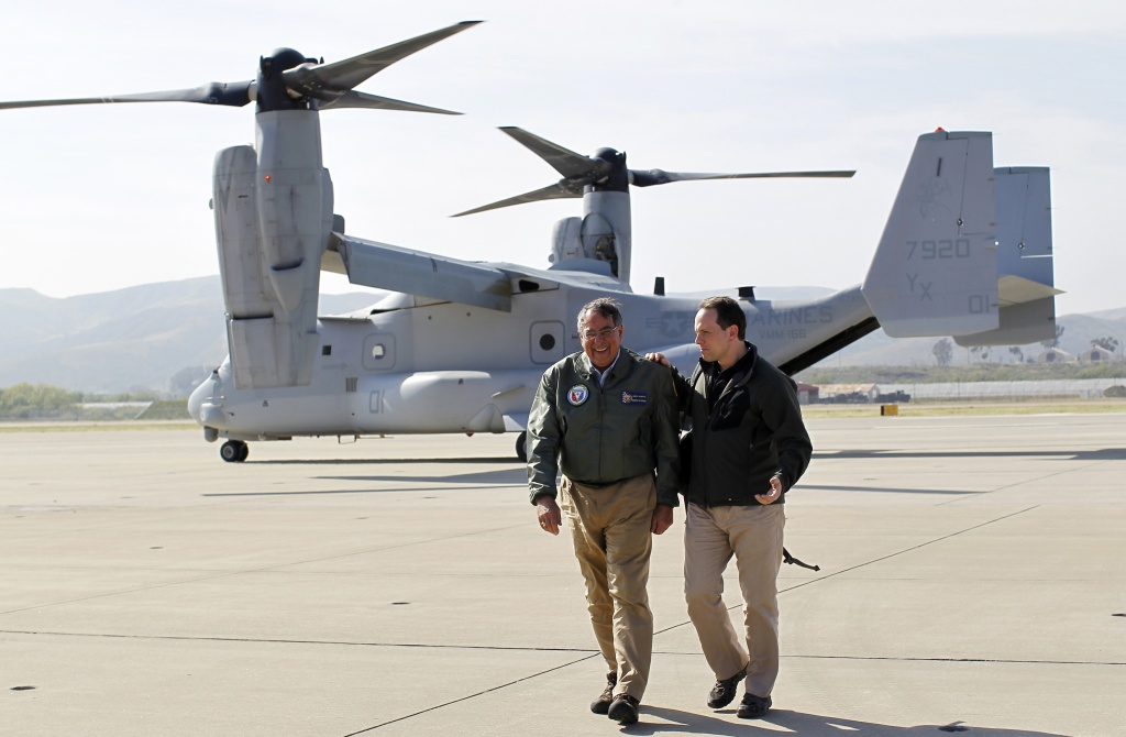 The Marine Corps has ordered the release of a sergeant whose murder conviction in the Hamdania Iraq war crime case was overturned. A Marine Corps spokesman said Sgt. Lawrence Hutchins was ordered freed from the brig Friday. (File photo: Former Secretary of Defense Leon Panetta (L) talks with his chief of staff Jeremy Bash after landing in an V-22 Osprey March 30, 2012 at Camp Pendleton)