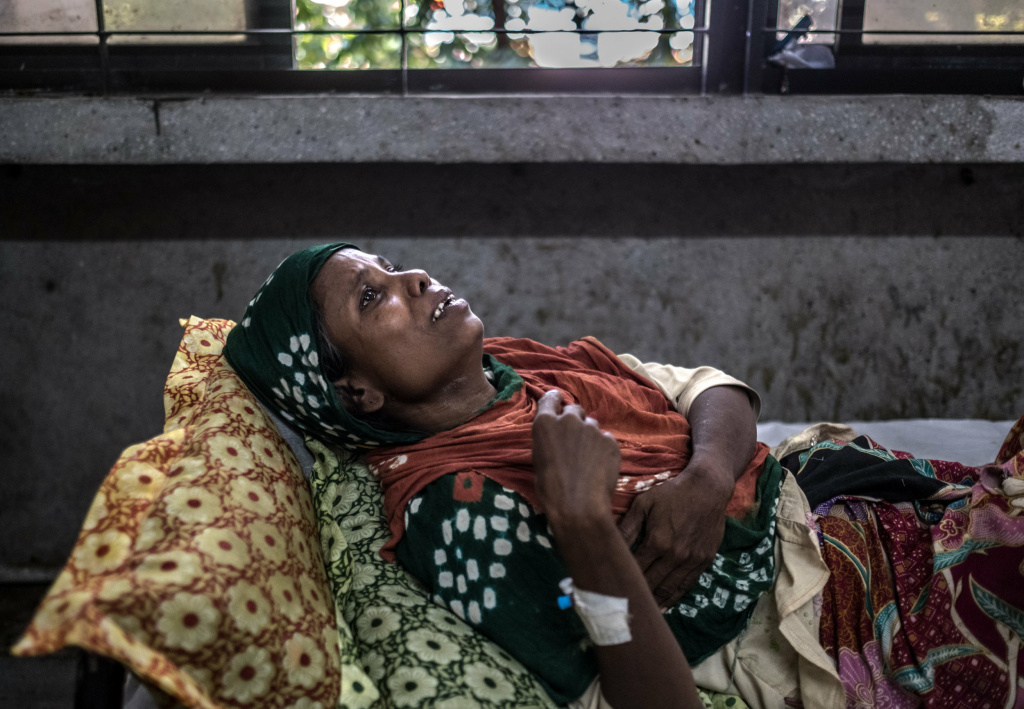 Morzina, a 40-year-old Rohingya refugee from Tangbazar, Myanmar, winces in pain at the Sadar Hospital in the Bangladeshi town of Cox's Bazar. Soldiers from Myanmar's army smashed her in the ribs with a rifle butt as they raided her home in early September.