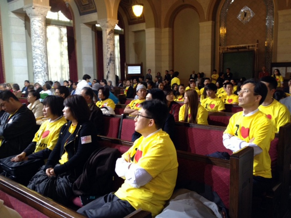 Koreatown residents sit in an L.A. City Council hearing on Wednesday, March 7, 2012, in protest over the new redistricting.