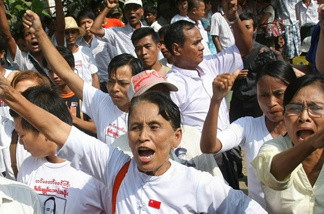 Supporters of Aung San Suu Kyi  gather in Yangon, Myanmar, in anticipation of her release Saturday.