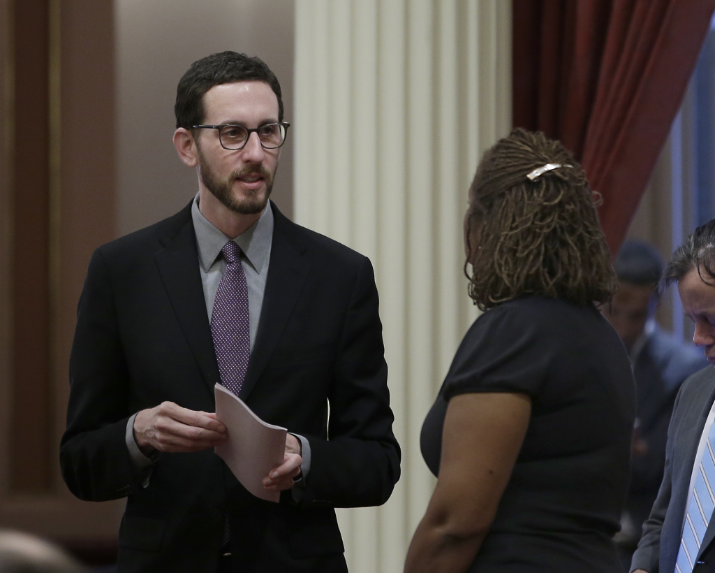 State Sen. Scott Wiener, D-San Francisco, left, talks with Sen. Holly Mitchell, D-Los Angeles, at the Capitol, Thursday, Jan. 26, 2017, in Sacramento, Calif. Wiener, and Sen. Toni Atkins, D-San Diego, introduced legislation on Thursday to add a non-binary gender option on state identifying documents including driver's licenses, birth certificates and identity cards.