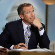 "Moderator Brian Williams watches a video which pays tribute to late moderator Tim Russert during a taping of ""Meet the Press"" at the NBC studios June 22, 2008 in Washington, DC."
