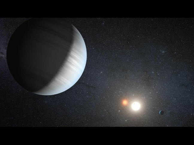 Sharing the Light of Two Suns: This artist's concept illustrates Kepler-47, the first transiting circumbinary system -- multiple planets orbiting two suns – 4,900 light-years from Earth, in the constellation Cygnus. The system was detected by NASA's Kepler space telescope, which measures minisucule changes in the brightness of more than 150,000 stars to search for planets that pass in front of or 'transit' their host star.
