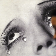 "A visitor looks at the photo ""Tears"" by"