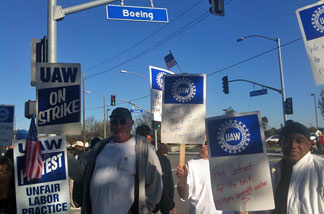Boeing employees picket in front of C-17 plant in Long Beach.