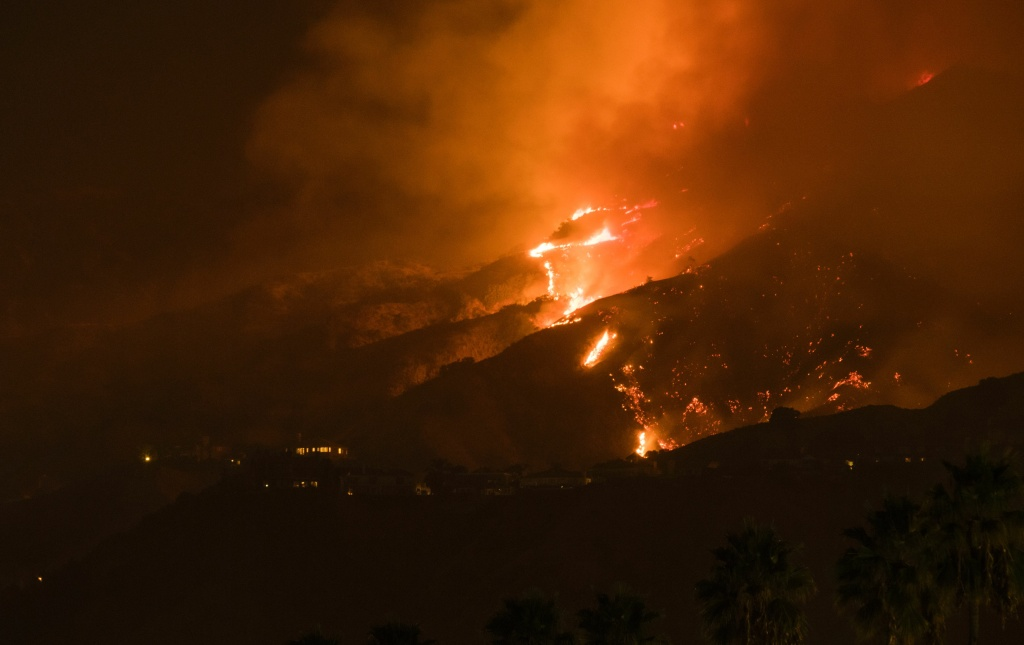 The La Tuna Fire burns in the hills above Burbank, early September 2, 2017.