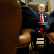President Donald Trump listens during a meeting with the National Association of Manufacturers in March in the Roosevelt Room of the White House.
