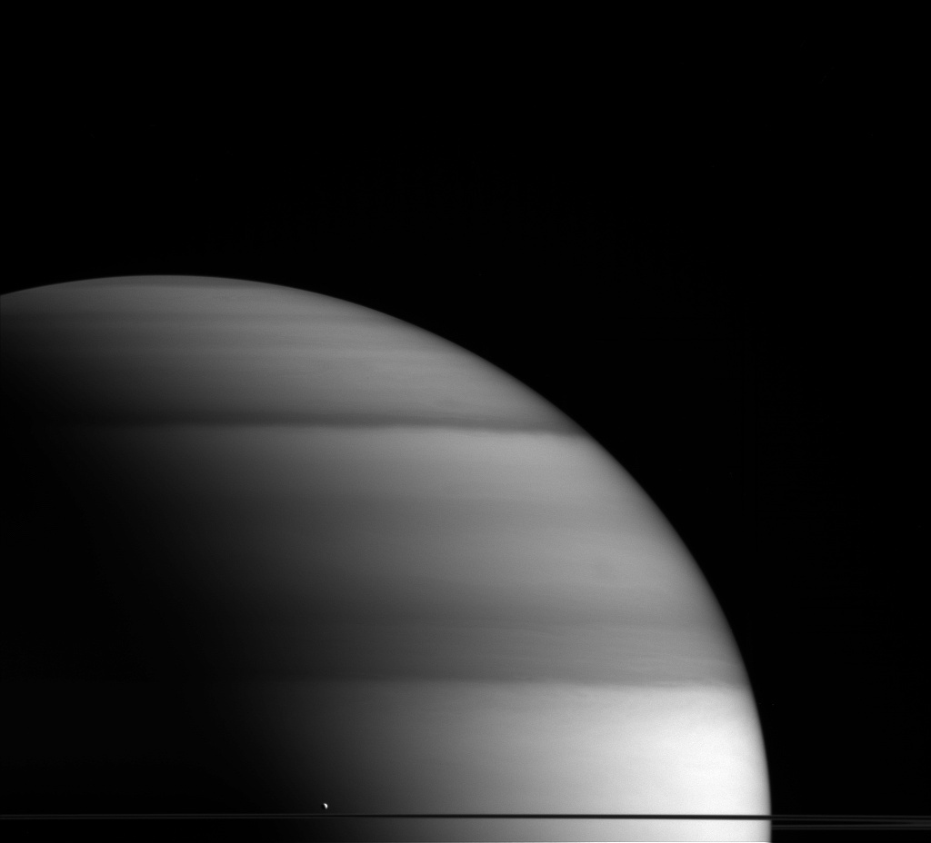 Enceladus, Saturn's sixth largest moon, floats amongst the gas giant's rings.