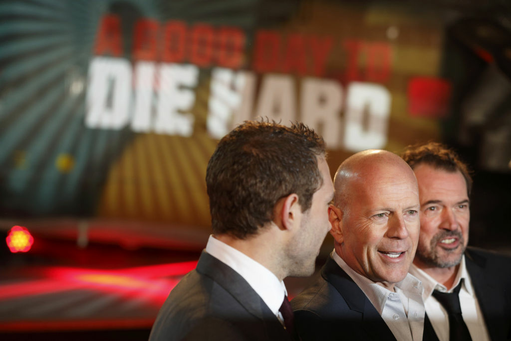 Australian actor Jai Courtney (L), US actor Bruce Willis (C) and German actor Sebastian Koch (R) pose for photographers while arriving for the UK premiere of 'A Good Day To Die Hard', the fifth film in the Die Hard franchise, in central London on February 7, 2013.