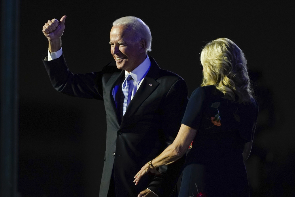 President-elect Joe Biden stands on stage with his wife, Jill Biden, on Saturday in Wilmington, Del. The incoming first lady is an English professor at Northern Virginia Community College.