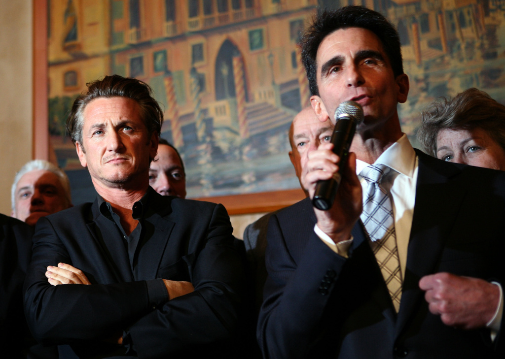 Actor Sean Penn (left) looks on as California Sen. Mark Leno (right) speaks during a press conference announcing legislation to create a Harvey Milk Day in California March 3, 2009 in San Francisco, California.