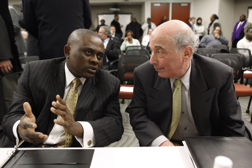 Dr. Bennet Omalu, left, Co-Director, Brain Injury Research Institute, West Virginia University talks with Dr. Ira R. Casson, Neurologist and former co-chairman, NFL Mild Traumatic Brain Injury Committee, before a House Judiciary Committee hearing entitled