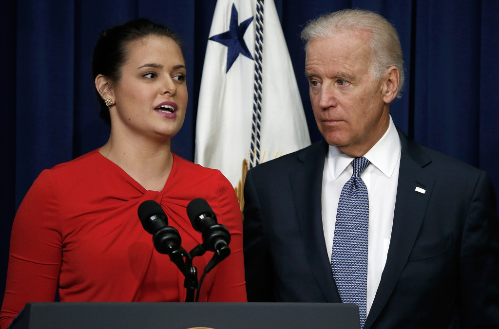 U.S Vice President Joe Biden (R) listens as Madeleine Smith, a graduate of Harvard University who was raped while attending college, speaks during an event at the Eisenhower Executive Office Building April 29, 2014 in Washington, DC.