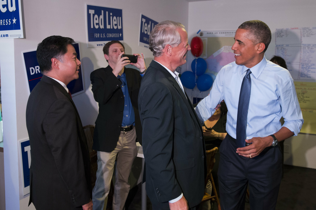 President Barack Obama, right, talks with Rep. Steve Israel, D-N.Y., during a visit to the campaign office State Senator Ted Lieu, left, who is running for Congress, on Thursday, Oct. 9, 2014, in Los Angeles. Obama is traveling in Los Angeles for an overnight trip during which he will discuss the nation's economy and designate a swath of Southern California mountains as a national monument.