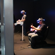 A player uses Sony's virtual reality headset, Project Morpheus, along with Playstation Move controllers at E3 on Tuesday, June 16, 2015.