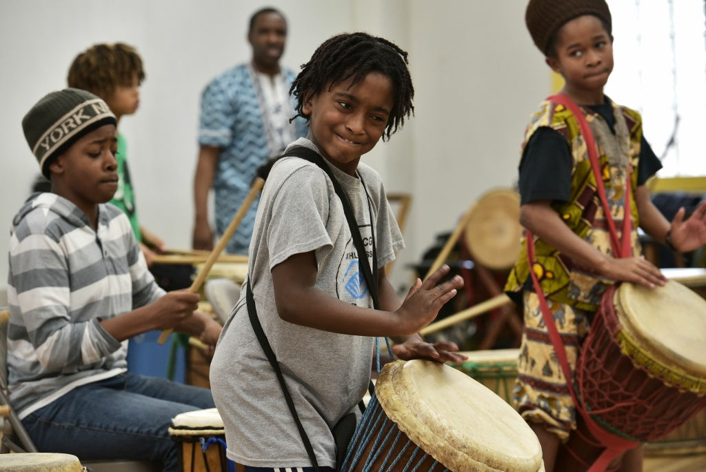 Ayinde, 10, who is homeschooled by his mother Monica Utsey, takes part in an African drumming class as an extracurricular activity in Mount Rainier, Maryland on February 24, 2017.