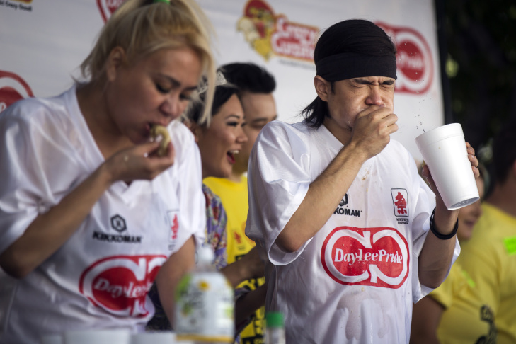 Professional eaters Miki Sudo, left, and Matt Stonie compete during the 2016 World Gyoza Eating Championship at the Japanese American Cultural and Community Center on Saturday, Aug. 20, 2016. Sudo took third place with 229 gyoza consumed in ten minutes while Stonie took first place with 323 gyoza.