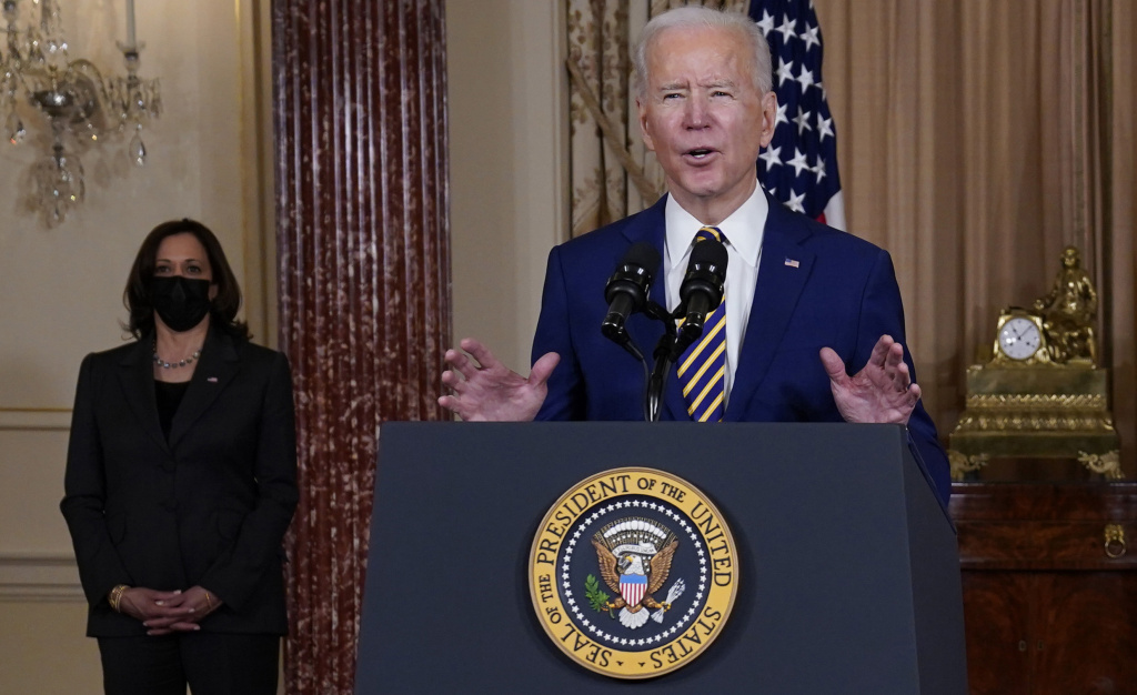 President Biden speaks at the State Department on Feb. 4 as Vice President Kamala Harris looks on.