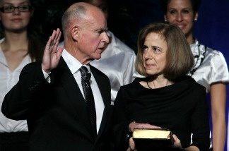 Anne Gust Brown (R) looks on as her husband Jerry Brown (L) is sworn in as the 39th governor of California by California on January 3, 2011 in Sacramento, California.