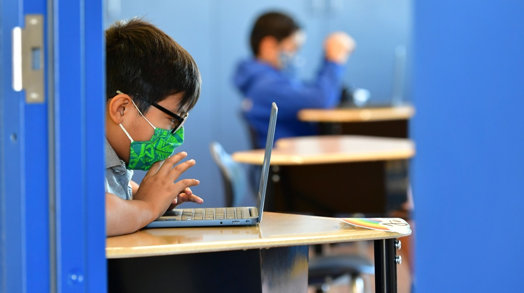 Students work on their laptop computers at St. Joseph Catholic School in La Puente, California on November 16, 2020, where pre-kindergarten to Second Grade students in need of special services returned to the classroom today for in-person instruction.