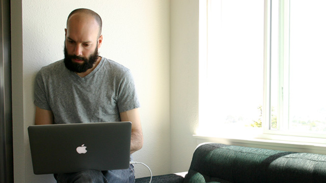 Patreon co-founder Jack Conte works in the living room of a Noe Valley apartment that served as the company's headquarters for eight months.