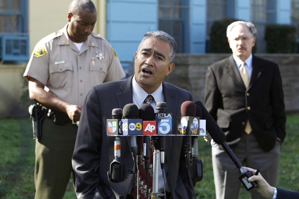 The Miramonte Elementary school's principal, Martin Sandoval speaks to the media outside his school in Los Angeles on Jan. 31, 2012.