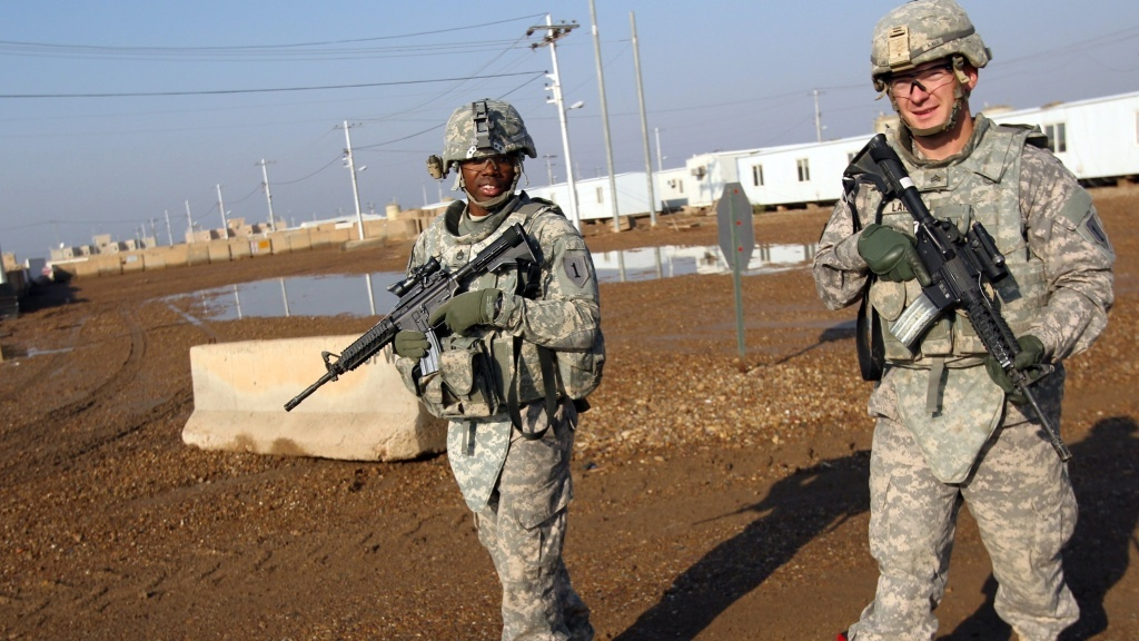 U.S. soldiers patrol the Taji base complex, which hosts Iraqi and U.S. troops north of the capital Baghdad. Taji is one of an eventual five sites where the U.S. and allied countries aim to train 5,000 Iraqi military personnel every six to eight weeks for combat against the so-called Islamic State.