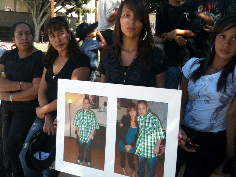 The Rosales family turned out in front of downtown L.A.'s Twin Towers jail Wednesday holding big photos of 18-year-old Jorge Rosales.