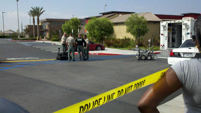 A robot is brought in by authorities after a potential explosive device was left following a Moreno Valley bank robbery.