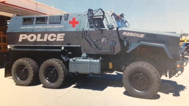 The school district has released two renderings of what the MRAP might look like after its tan military color is painted over. In one version, it's police blue; another depicts it as more of an ambulance, white with a red cross.